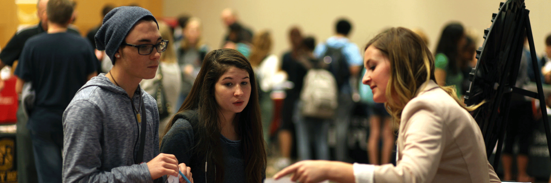 A photo of students participating in a career event on campus.