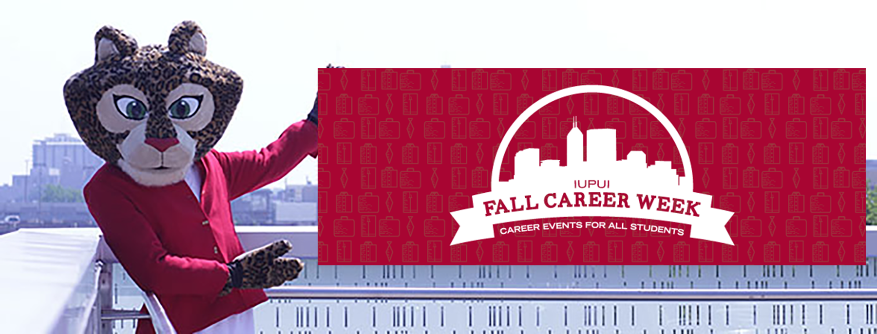 Jazzy the Jaguar mascot pointing to fall career week banner